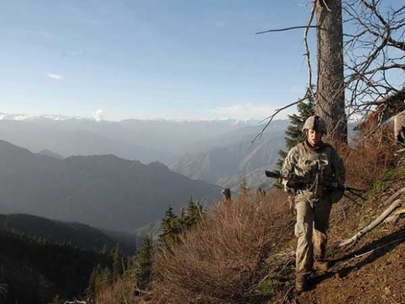 Spc. Andrew Harvey, a 1st Infantry Soldier, patrols along steep cliffs of the Korengal Valley's surrounding mountains during Operation Viper Shake, Afghanistan, April 21, 2009. Photo courtesy army.mil.