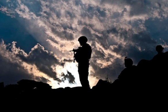 The sun sets behind U.S. Army Sgt. 1st Class Jamie R. Johnson, a platoon sergeant from Bayonet Company, 2nd Battalion, 327th Infantry Regiment, Task Force No Slack, in Afghanistan's Kunar Province March 17. Photo by U.S. Army Sgt. 1st Class Mark Burrell, 210th MPAD