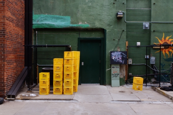 Stacks of yellow crates
