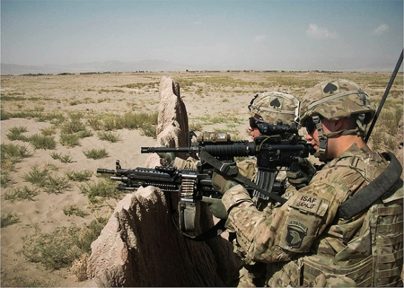 U.S. Army Pfc. Michael W. Daley Jr. (right) and Pfc. Travis B. Woolwine, both Soldiers with 1st Battalion, 506th Infantry Regiment, 4th Brigade Combat Team, 101st Airborne Division (Air Assault), scan their surroundings while on patrol in Paktya Province, Afghanistan / Photo by Sgt. Justin Moeller
