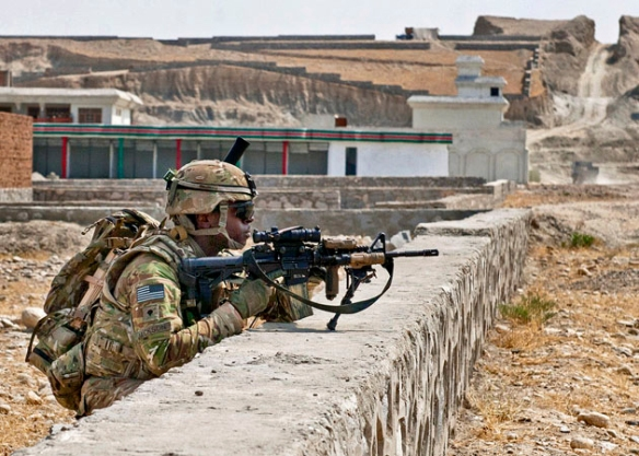 US Army Spc. Kevin Jackson, 4th Squadron, 9th Cavalry Regiment, 2nd Armored Brigade Combat Team, 1st Cavalry Division, pulls security during a reconnaissance mission in a village south of Forward Operating Base Fenty, Nangarhar province, Afghanistan, Sept. 8, 2013 / Photo by Sgt. Margaret Taylor