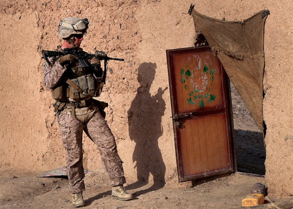 Cpl. Zachery K. Arrowood with 1st Battalion, 9th Marine Regiment, provides security during a patrol in Helmand province, Afghanistan, Oct. 12, 2013. The patrol was conducted to disrupt enemy activity in the area / Photo by Lance Cpl. Zachery B. Martin