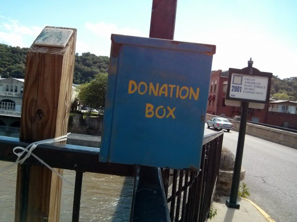 Elkader, bridge donation box
