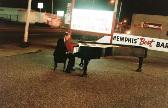 Eggleston at a piano (photo by Juergen Teller)