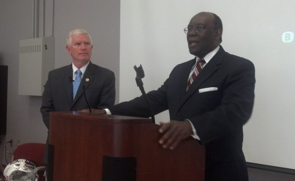Congressman Mo Brooks (left) watches a negro.