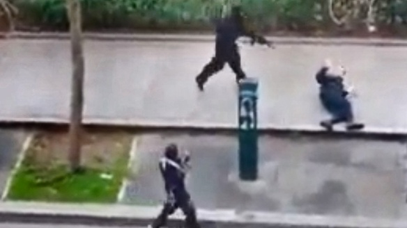 Charlie Hebdo attackers killing a police officer as he's defenseless on the ground.