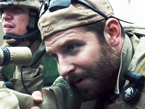 Bradley Cooper (as Chris Kyle) sighting in on an Iraqi mother