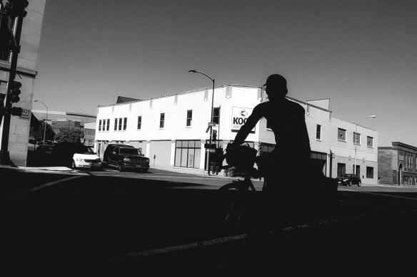 cyclist in shadow