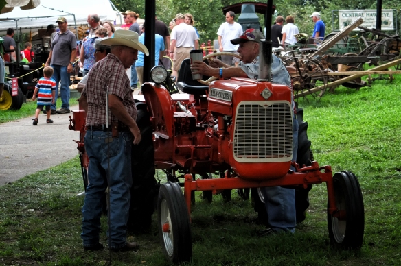 Bromance -- bonding over an Allis-Chalmers tractor.